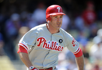 LOS ANGELES, CA - AUGUST 10:  Chase Utley #26 of the Philadelphia Phillies runs out a single against the Los Angeles Dodgers at Dodger Stadium on August 10, 2011 in Los Angeles, California.  (Photo by Harry How/Getty Images)