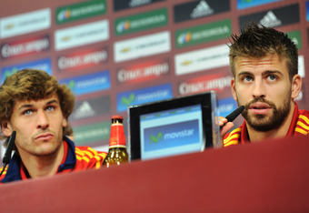 GNIEWINO, POLAND - JUNE 08:  Gerard Pique (R) of Spain answers questions from the media alongside his teammate Fernando Llorente during their joint press conference after a training session with the Spanish team ahead of UEFA EURO 2012 on June 8, 2012 in