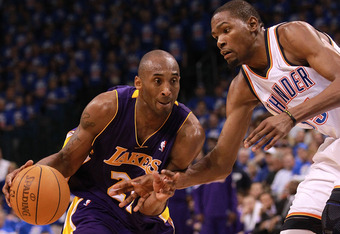 OKLAHOMA CITY, OK - MAY 21:  Kobe Bryant #24 of the Los Angeles Lakers dribbles the ball against Kevin Durant of the Oklahoma City Thunder  during Game Five of the Western Conference Semifinals of the 2012 NBA Playoffs at Chesapeake Energy Arena on May 21