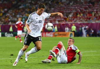 L'VIV, UKRAINE - JUNE 17:  Mario Gomez of Germany and Daniel Agger of Denmark compete for the ball during the UEFA EURO 2012 group B match between Denmark and Germany at Arena Lviv on June 17, 2012 in L'viv, Ukraine.  (Photo by Martin Rose/Getty Images)
