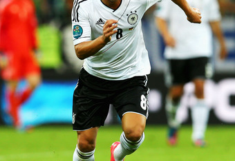 GDANSK, POLAND - JUNE 22:  Mesut Ozil of Germany in action during the UEFA EURO 2012 quarter final match between Germany and Greece at The Municipal Stadium on June 22, 2012 in Gdansk, Poland.  (Photo by Alex Grimm/Getty Images)