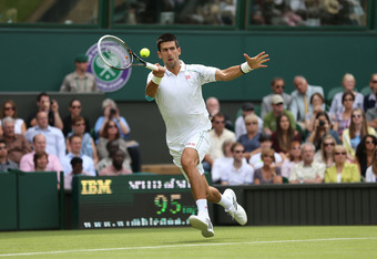 LONDON, ENGLAND - JUNE 25:  Novak Djokovic of Serbia hits a forehand return during his mens singles first round match against Juan Carlos Ferrero of Spain on day one of the Wimbledon Lawn Tennis Championships at the All England Lawn Tennis and Croquet Clu