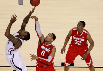 NEW ORLEANS, LA - MARCH 31:  Thomas Robinson #0 of the Kansas Jayhawks puts up a shot over Jared Sullinger #0 of the Ohio State Buckeyes during the National Semifinal game of the 2012 NCAA Division I Men's Basketball Championship at the Mercedes-Benz Supe