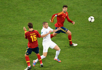 DONETSK, UKRAINE - JUNE 23:  Karim Benzema of France is closed down by Sergio Ramos and Gerard Pique of Spain during the UEFA EURO 2012 quarter final match between Spain and France at Donbass Arena on June 23, 2012 in Donetsk, Ukraine.  (Photo by Jasper J