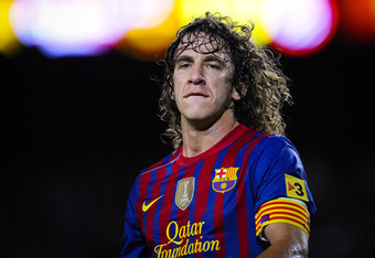 BARCELONA, SPAIN - MAY 05:  Carles Puyol of FC Barcelona looks on during the La Liga match between FC Barcelona and RCD Espanyol at Camp Nou on May 5, 2012 in Barcelona, Spain.  (Photo by David Ramos/Getty Images)