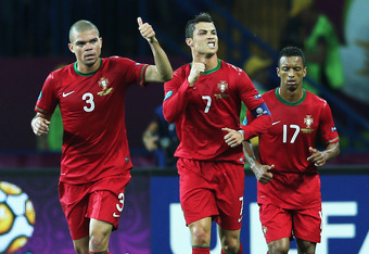 KHARKOV, UKRAINE - JUNE 17:  Cristiano Ronaldo (C) of Portugal celebrates with team-mates Pepe (L) and Nani after scoring his team's first goal during the UEFA EURO 2012 group B match between Portugal and Netherlands at Metalist Stadium on June 17, 2012 i