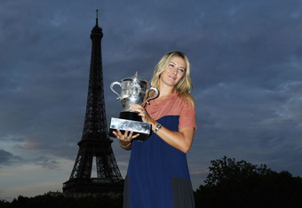 PARIS, FRANCE - JUNE 09:  French Open women's champion Maria Sharapova of Russia poses with the Coupe Suzanne Lenglen backdropped by the Eiffel Tower after her victory earlier in the day in the women's singles final against Sara Errani of Italy during day