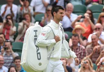 LONDON, ENGLAND - JUNE 25:  Novak Djokovic of Serbia walks onto centre court ahead of his mens singles first round match against Juan Carlos Ferrero of Spain on day one of the Wimbledon Lawn Tennis Championships at the All England Lawn Tennis and Croquet