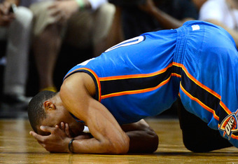 MIAMI, FL - JUNE 21:  Russell Westbrook #0 of the Oklahoma City Thunder covers his face as he kneels on the court in the second half against the Miami Heat in Game Five of the 2012 NBA Finals on June 21, 2012 at American Airlines Arena in Miami, Florida.