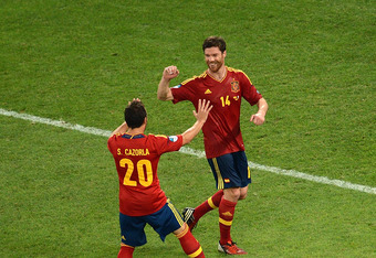 DONETSK, UKRAINE - JUNE 23: Xabi Alonso of Spain celebrates after scoring the second goal with Santi Cazorla during the UEFA EURO 2012 quarter final match between Spain and France at Donbass Arena on June 23, 2012 in Donetsk, Ukraine.  (Photo by Jasper Ju