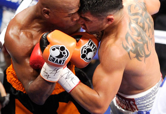LAS VEGAS, NV - SEPTEMBER 17:  Floyd Mayweather Jr. (L) and Victor Ortiz battle in the second round of their WBC welterweight title fight at the MGM Grand Garden Arena September 17, 2011 in Las Vegas, Nevada. Mayweather knocked out Ortiz in the fourth rou