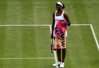 LONDON, ENGLAND - JUNE 25:  Venus Williams of USA shows her frustration during her womens singles first round match against Elena Vesnina of Russia on day one of the Wimbledon Lawn Tennis Championships at the All England Lawn Tennis and Croquet Club on Ju