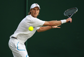 LONDON, ENGLAND - JUNE 25:  Andreas Seppi of Italy eyes the ball during his mens singles first round match against Denis Istomin of of Uzbekistan on day one of the Wimbledon Lawn Tennis Championships at the All England Lawn Tennis and Croquet Club on June