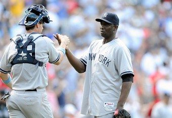 WASHINGTON, DC - JUNE 17:  Rafael Soriano #29 of the New York Yankees celebrates with Chris Stewart #19 after a 4-1 victory against the Washington Nationals at Nationals Park on June 17, 2012 in Washington, DC.  (Photo by Greg Fiume/Getty Images)