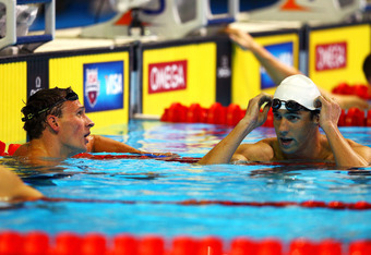 OMAHA, NE - JUNE 25:  (L-R) Ryan Lochte and Michael Phelps look on after they conpeted in the championship final heat of the Men's 400 m Individual Medely during the 2012 U.S. Olympic Swimming Team Trials at CenturyLink Center on June 25, 2012 in Omaha, N