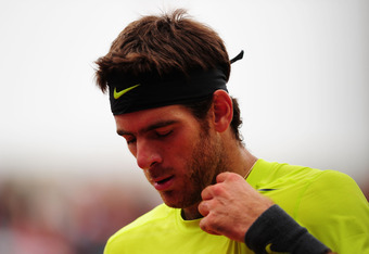 PARIS, FRANCE - JUNE 05:  Juan Martin Del Potro of Argentina reacts in his men's singles quarter final match against Roger Federer of Switzerland during day 10 of the French Open at Roland Garros on June 5, 2012 in Paris, France.  (Photo by Mike Hewitt/Ge