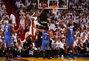 MIAMI, FL - JUNE 19:  LeBron James #6 of the Miami Heat drives for a shot attempt in the second half against Thabo Sefolosha #2 of the Oklahoma City Thunder in Game Four of the 2012 NBA Finals on June 19, 2012 at American Airlines Arena in Miami, Florida.