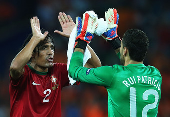 KHARKOV, UKRAINE - JUNE 17:  Bruno Alves (L) of Portugal celebrates victory with team-mate Rui Patricio after the UEFA EURO 2012 group B match between Portugal and Netherlands at Metalist Stadium on June 17, 2012 in Kharkov, Ukraine.  (Photo by Julian Fin