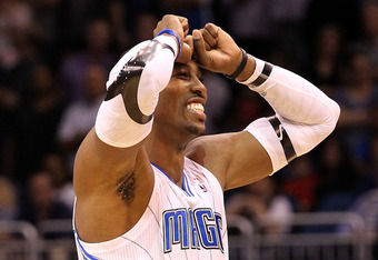 ORLANDO, FL - MARCH 13:  Dwight Howard #12 of the Orlando Magic reacts to a missed free-throw during the game against the Miami Heat at Amway Center on March 13, 2012 in Orlando, Florida.  NOTE TO USER: User expressly acknowledges and agrees that, by down