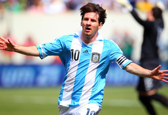 EAST RUTHERFORD, NJ - JUNE 9: Lionel Messi #10 of Argentina reacts after scoring his second of two goals during the first half of an international friendly soccer match on June 9, 2012 at MetLife Stadium in East Rutherford, New Jersey. (Photo by Rich Schu