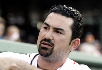 BOSTON, MA - JUNE 21:  Adrian Gonzalez #28 of the Boston Red Sox signs autographs before their game against the Miami Marlins at Fenway Park on June 21, 2012 in Boston, Massachusetts.  (Photo by Winslow Townson/Getty Images)