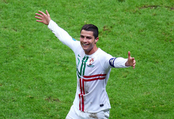 WARSAW, POLAND - JUNE 21:  Cristiano Ronaldo of Portugal celebrates scoring the opening goal with a header during the UEFA EURO 2012 quarter final match between Czech Republic and Portugal at The National Stadium on June 21, 2012 in Warsaw, Poland.  (Phot