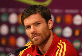DONETSK, UKRAINE - JUNE 23:  In this handout image provided by UEFA, Xabi Alonso of Spain talks to the media after the UEFA EURO 2012 Quarter Final match between Spain and France on June 23, 2012 in Donetsk, Ukraine.  (Photo by Handout/UEFA via Getty Imag
