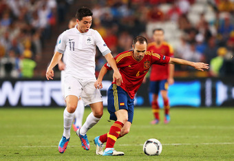 DONETSK, UKRAINE - JUNE 23: Samir Nasri of France and Andres Iniesta of Spain challenge for the ball during the UEFA EURO 2012 quarter final match between Spain and France at Donbass Arena on June 23, 2012 in Donetsk, Ukraine.  (Photo by Alex Livesey/Gett