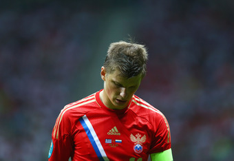 WARSAW, POLAND - JUNE 16: Andrey Arshavin of Russia looks dejected during the UEFA EURO 2012 group A match between Greece and Russia at The National Stadium on June 16, 2012 in Warsaw, Poland.  (Photo by Shaun Botterill/Getty Images)