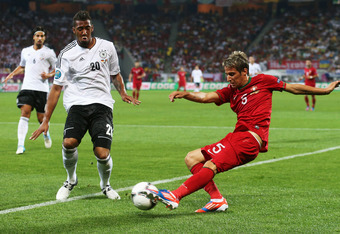 L'VIV, UKRAINE - JUNE 09: Fabio Coentrao of Portugal crosses the ball past Jerome Boateng of Germany during the UEFA EURO 2012 group B match between Germany and Portugal at Arena Lviv on June 9, 2012 in L'viv, Ukraine.  (Photo by Joern Pollex/Getty Images