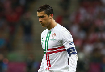 WARSAW, POLAND - JUNE 21:  Cristiano Ronaldo of Portugal prepares to take a free kick during the UEFA EURO 2012 quarter final match between Czech Republic and Portugal at The National Stadium on June 21, 2012 in Warsaw, Poland.  (Photo by Alex Grimm/Getty