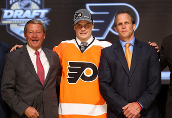 PITTSBURGH, PA - JUNE 22:  Scott Laughton (C), 20th pick overall by the Philadelphia Flyers, poses with Flyers representatives on stage during Round One of the 2012 NHL Entry Draft at Consol Energy Center on June 22, 2012 in Pittsburgh, Pennsylvania.  (Ph
