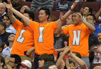 PHILADELPHIA, PA - MARCH 21: Jeremy Lin fans cheer during the game between the New York Knicks and Philadelphia 76ers at the Wells Fargo Center on March 21, 2012 in Philadelphia, Pennsylvania. The Knicks won 82-79. NOTE TO USER: User expressly acknowledge