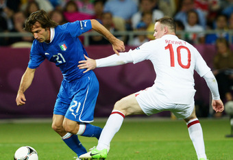 KIEV, UKRAINE - JUNE 24: Andrea Pirlo of Italy and Wayne Rooney of England challenge for the ball during the UEFA EURO 2012 quarter final match between England and Italy at The Olympic Stadium on June 24, 2012 in Kiev, Ukraine.  (Photo by Claudio Villa/Ge