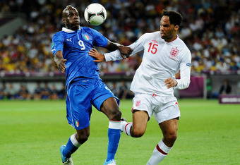 KIEV, UKRAINE - JUNE 24:  Mario Balotelli of Italy and Joleon Lescott of England battle for the ball during the UEFA EURO 2012 quarter final match between England and Italy at The Olympic Stadium on June 24, 2012 in Kiev, Ukraine.  (Photo by Claudio Villa