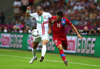 WARSAW, POLAND - JUNE 21:  Pepe of Portugal and Milan Baros of Czech Republic tussle for the ball during the UEFA EURO 2012 quarter final match between Czech Republic and Portugal at The National Stadium on June 21, 2012 in Warsaw, Poland.  (Photo by Alex