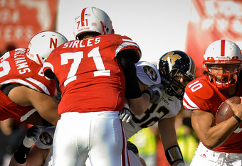 LINCOLN, NE - OCTOBER 30: Running back Roy Helu Jr. #10 of the Nebraska Cornhuskers , with the help of teammates  offensive linesman Jeremiah Sirles #71 and  offensive linesman Keith Williams #68 break a long run against the Missouri Tigers during second