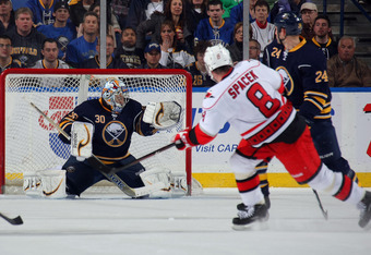 BUFFALO, NY - MARCH 7:  Ryan Miller #30 of the Buffalo Sabres makes a save on Jaroslav Spacek #8 of the Carolina Hurricanes as Robyn Regehr #24 of the Buffalo Sabres defends during their NHL game at First Niagara Center on March 7, 2012 in Buffalo, New Yo