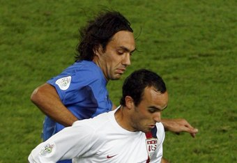 KAISERSLAUTERN, GERMANY - JUNE 17:  Landon Donovan of the USA is challenged by Alessandro Nesta of Italy during the FIFA World Cup Germany 2006 Group E match between Italy and USA at the Fritz-Walter Stadium on June 17, 2006 in Kaiserslautern, Germany.
