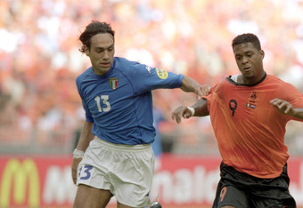 29 Jun 2000:  Patrick Kluivert of Holland is being held by Alessandro Nesta of Italy during the European Championships 2000 Semi-final at the Amsterdam ArenA, Amsterdam, Holland. The match was drawn 0-0 after extra time, Italy won 3-1 on penalties. \ Mand