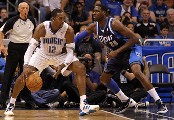 ORLANDO, FL - MARCH 30:  Dwight Howard #12 of the Orlando Magic drives aganst Ian Mahinmi #28 of the Dallas Mavericks during the game at Amway Center on March 30, 2012 in Orlando, Florida.  NOTE TO USER: User expressly acknowledges and agrees that, by dow