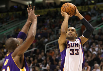 PHOENIX, AZ - FEBRUARY 19:  Grant Hill #33 of the Phoenix Suns puts up a shot during the NBA game against the Los Angeles Lakers at US Airways Center on February 19, 2012 in Phoenix, Arizona.  The Suns defeated the Lakers 102-90.  NOTE TO USER: User expre