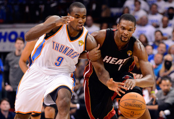 OKLAHOMA CITY, OK - JUNE 14:  Serge Ibaka #9 of the Oklahoma City Thunder and Chris Bosh #1 of the Miami Heat go after a loose ball in the second quarter in Game Two of the 2012 NBA Finals at Chesapeake Energy Arena on June 14, 2012 in Oklahoma City, Okla