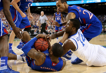 Kidd-Gilchrist fighting for the ball against three Kansas defenders