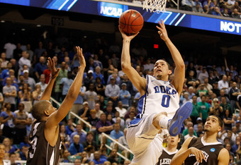 GREENSBORO, NC - MARCH 16:  Austin Rivers #0 of the Duke Blue Devils goes up for a shot over C.J. McCollum #3 of the Lehigh Mountain Hawks in the second half during the second round of the 2012 NCAA Men's Basketball Tournament at Greensboro Coliseum on Ma