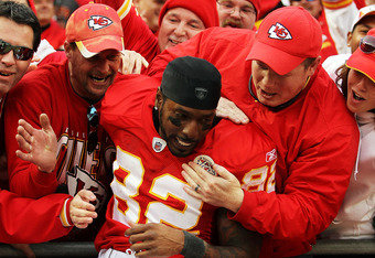 KANSAS CITY, MO - DECEMBER 18:  Dwayne Bowe #82 of the Kansas City Chiefs celebrates by jumping into the standfs after the Chiefs defeated the Green Bay Packers 19-14 to win the game on December 18, 2011 at Arrowhead Stadium in Kansas City, Missouri.  (Ph