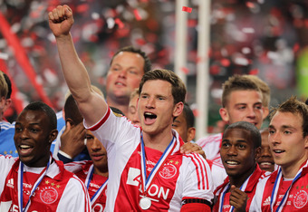 AMSTERDAM, NETHERLANDS - MAY 02:  Captain, Jan Vertonghen of Ajax holds the trophy and leads celebrations after winning the Eredivisie League title at Amsterdam Arena on May 2, 2012 in Amsterdam, Netherlands.  (Photo by Dean Mouhtaropoulos/Getty Images)