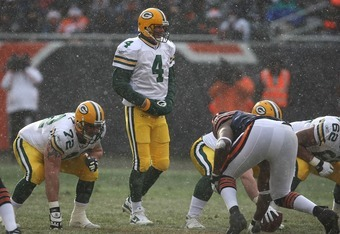 CHICAGO - DECEMBER 23: Brett Favre #4 of the Green Bay Packers walks up to the line of scrimmage in snow and swirling wind against the Chicago Bears on December 23, 2007 at Soldier Field in Chicago, Illinois.  (Photo by Jonathan Daniel/Getty Images)