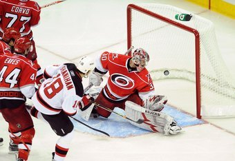 RALEIGH, NC - APRIL 21:  Brendan Shanahan #18 of the New Jersey Devils makes a goal past goalie Cam Ward #30 of the Carolina Hurricanes during Game Four of the Eastern Conference Quarterfinals of the 2009 Stanley Cup Playoffs on April 21, 2009 at the RBC