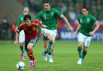 GDANSK, POLAND - JUNE 14:  David Silva (L) of Spain pulls away from Stephen Ward of Ireland during the UEFA EURO 2012 group C match between Spain and Ireland at The Municipal Stadium on June 14, 2012 in Gdansk, Poland.  (Photo by Michael Steele/Getty Imag